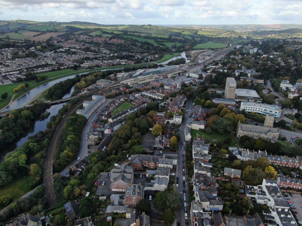 An alternative aerial drone shot of St Davids Station in Exeter, Devon, England, UK